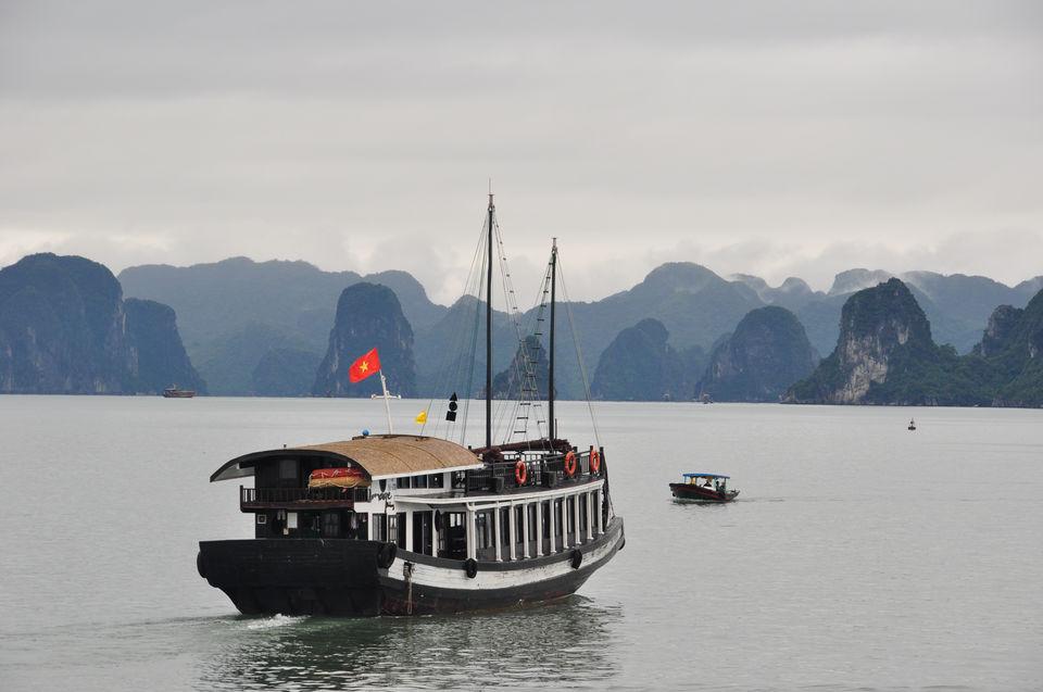 Junk on Ha Long Bay in fog.