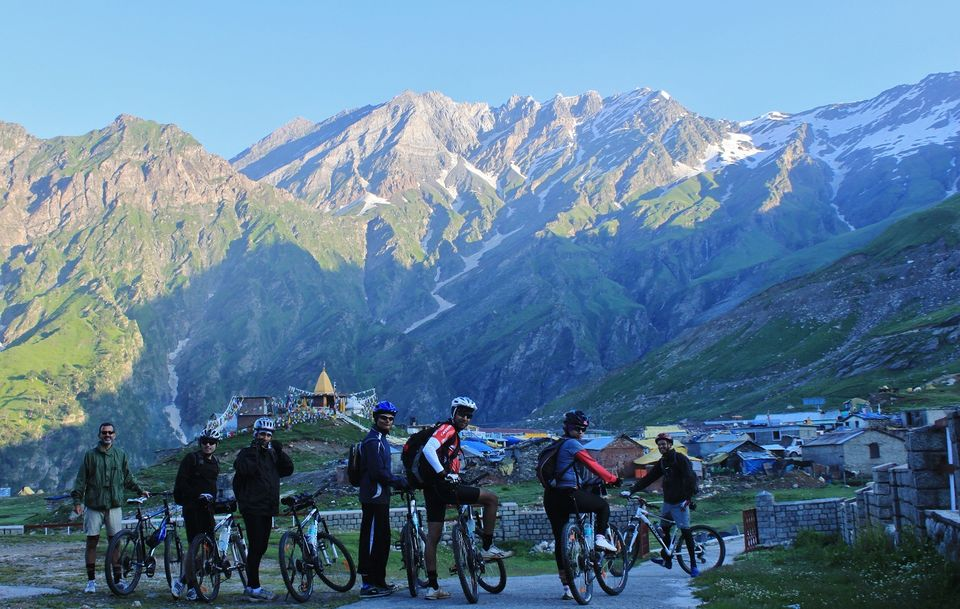 Photos of Marhi in the backdrop of enthusiast cyclists by Aftab Singh