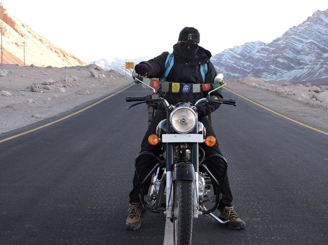 This Man is taking the challenge of riding a 110 cc motorbike from Bangalore to Bangkok