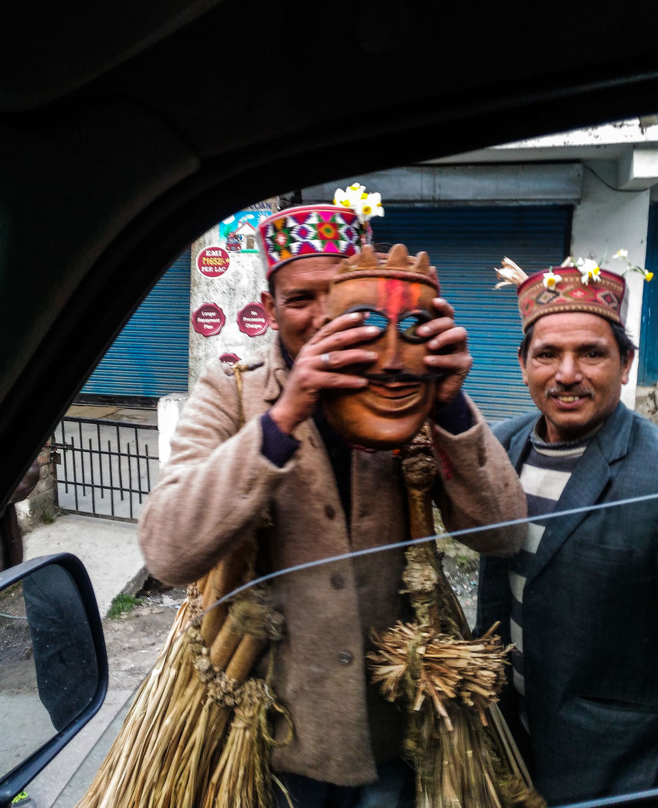Photo of A rather happy 'apdevta' showing me his mask by Monidipa Bose