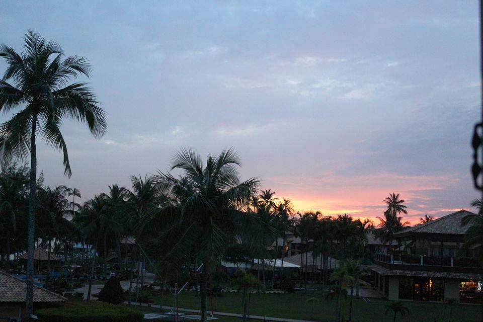 Sun playing hide n seek behind resort