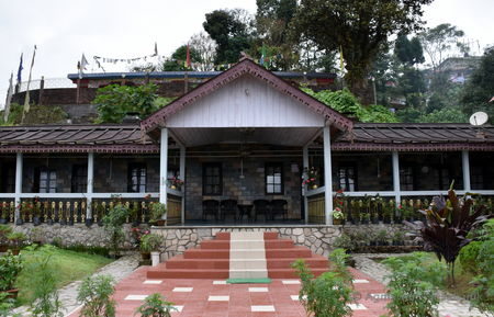 Staying at a century old bungalow while sipping tea is the best thing you can do at Takdah