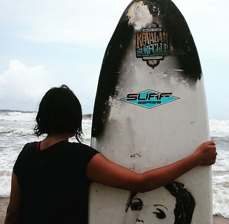 Riding the waves : Surfing with Kovalam surf club