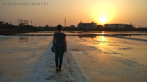 Sunset Conversations amidst the White Fields of Bassein · Steps and Streets