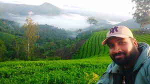 Bliss of Lush Green Tea Plantation Valleys #SelfieWithAView #TripotoCommunity
