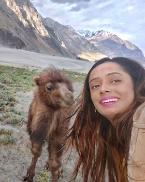 Oh look at that smile. Totally stealing my thunder, boy!  Double humped bacterian camels of Ladakh.