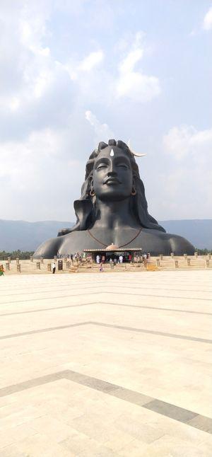 Statue hidden between the mountains