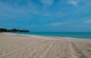 This beach is named the golden beach beach with wide white sand and calm sea water can be your place