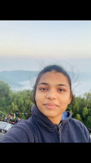 Right behind me is the peak of Kangchenjunga in the mist #SelfieWithAView #TripotoCommunity