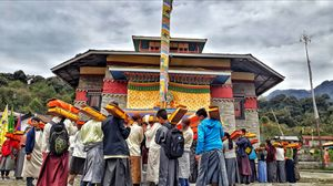 """""""Bumkoor puja"""" puja which celebrates by all buddhist, where sacred book(pustak) use to take round."""