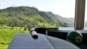 Rolling hills, a lush valley, and a distant tea factory. #summerescape #IssSummerBaharNikal
