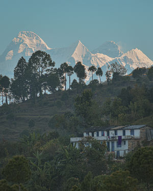 In frame Mt. Nanda Devi and Palari Village, Bageshwar, Uttarakhand.