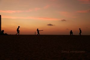 Enjoying the beautiful silhouettes created by sunset on the beach