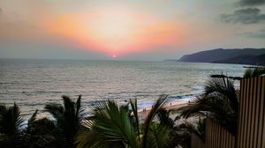 Serene sunset at Cola beach, Goa