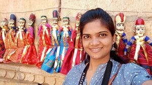 colorful puppets hanging on wall at Jaisalmer, Rajasthan, India#SelfieWithAView#TripotoCommunity