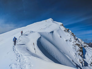 Sar Pass - A frozen lake, a ridge and snow slides at 14k feet