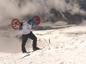Man of steel: Russian climbs Mount Elbrus with 75 kg barbell on his back