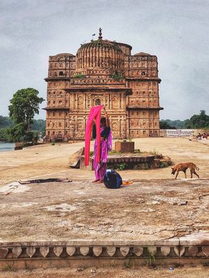 Colours of Orccha. A woman drying clothes on the ghats of Betwa river in Orchha, Madhya Pradesh.