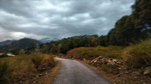 In rain, dear mountains