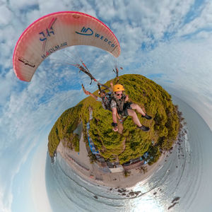 360 selfie with an epic view of a hill with a beach front #selfiewithaview #tripotocommunity