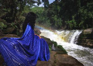Travel girl in sharee at mighty Nafakhum Waterfall