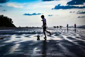 Setting sun... Cool breeze.. splashing waves..  lets play.! The lost games of childhood.