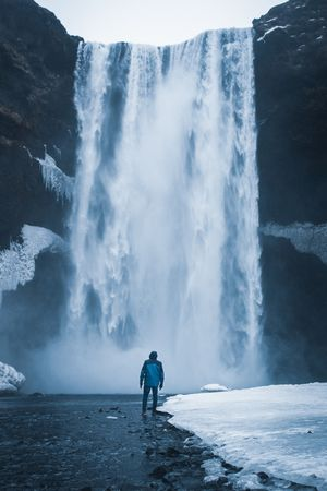 Feeling small under the most powerful waterfall in Iceland.                    Instagram: mo__aamir