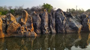 Cliff Jumping Off The Rocks Of Hampi