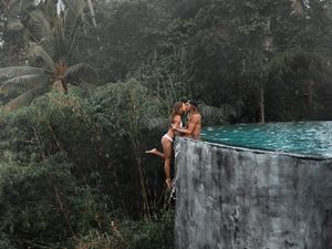 What Happened When a Couple Hung off the Edge of an Infinity Pool to Strike a Pose