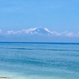 Smell the sea and look high to the mountains! A rare view of mountains in Bali from the Gili island!