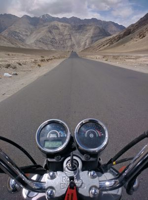 On the cool Ladakh Highway, cool wind in my hair!  The smell of colitas, rising up through the air.