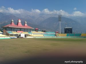 What will u watch  ?  The match in the stadium  or that  scenic view behind .