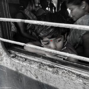 Innocence in the busy world  Theme : Street photography  #BestTravelpicture  @tripotocommunity