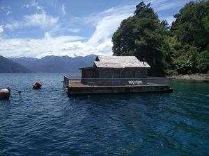 Cabin in lake  Todos los Santos in Puerto Varas, southern Chile. #besttravelpictures #jetairways
