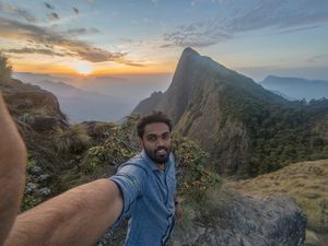 #SelfieWithAView #TripotoCommunity  Breathtaking view of sunrise from the highest tea plantation in
