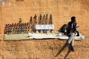 Rajasthani man selling Ravanahatha the Rajasthani folk musical instrument at Jaisalmer in Rajasthan