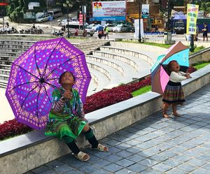 These tiny street peddlers in Sa Pa, take a break from their job to admire the sky above.