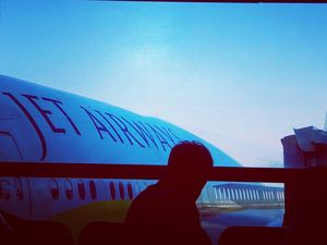 A man is Waiting for into aboard with JetAirways Boeing 777-300ER#BestTravelPictures#tripotocommunty