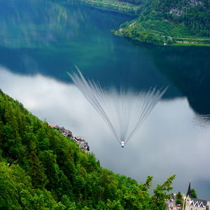 Here is a wake created by the boat on the still lake Hallstatt (Austria). #BestTravelPictures