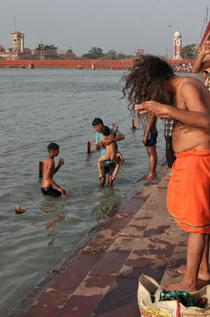 In the name of the Father, the Son and the Holy Spirit-- an early morning shot by the Ganges