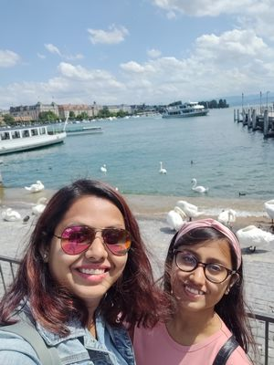Selfie with my little sister. Behind is the beautiful Zurich sea and the swans are added toppings
