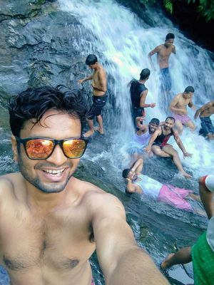 I was in my hometown. Me and my friends having fun in Borjhar waterfall. l like this picture.