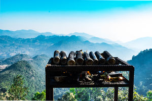 The picture was taken in Araku Valley. Preparation of bamboo mutton amidst the mountains and winds.