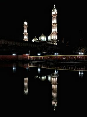 REFLECTIONS : Taj-ul-Masjid located at old bhopal beside lake Moti Talab.
