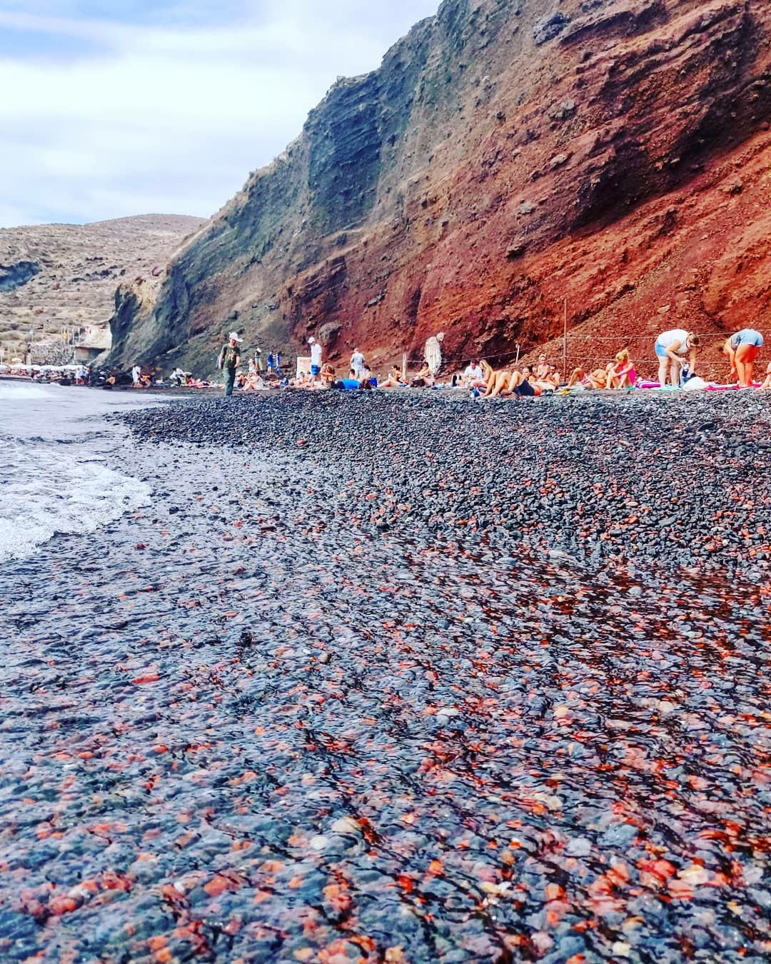 Photo of Red beach By The Travelling Chhori