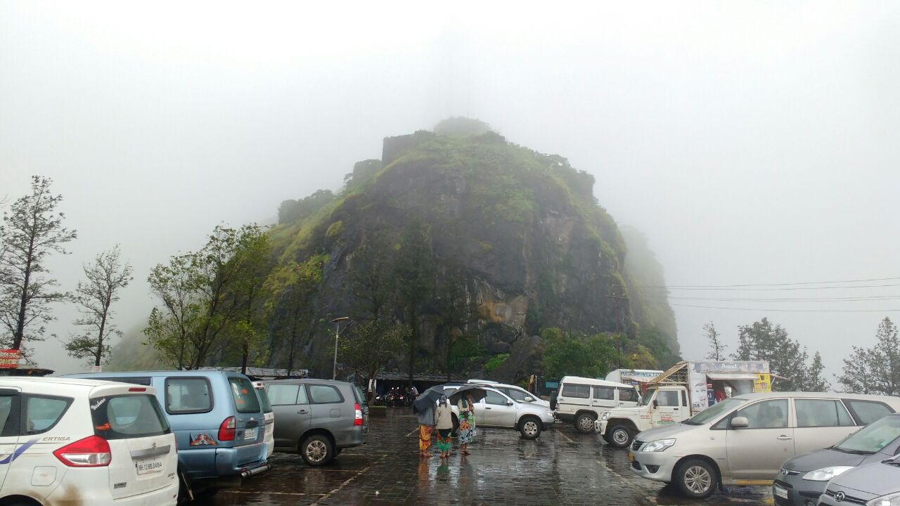 Photo of Sinhagad Fort, Pune, with heavy rain and awesome foggy cloudy climate! By Junaid Khalil