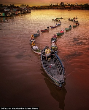 The floating markets of Indonesia with long lines of as many as 20 boats!