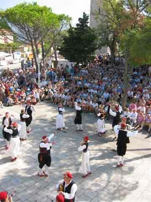 Traditional local costumes, dance and songs