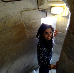 Beaming with joy at Leaning tower of Pisa