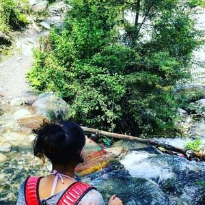 By a fierce river.